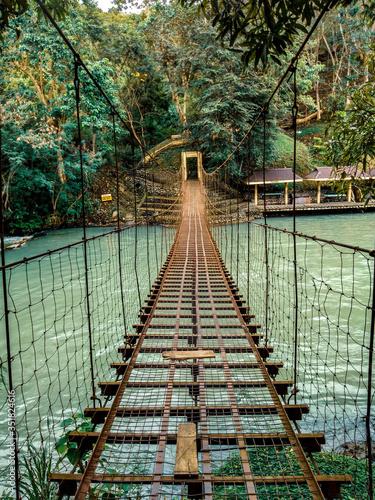 Stampa su Tela Empty Footbridge Over River In Forest