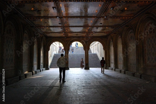 Photo Rear View Of People Walking At Bethesda Fountain Archway