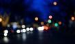 Defocused Image Of Illuminated Colorful Lights On Street At Night