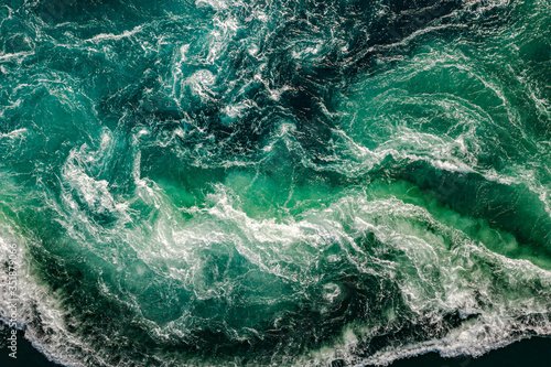 Fototapeta Waves of water of the river and the sea meet each other during high tide and low tide obraz