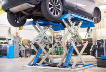 Lifted Car Without Wheel Waiti...