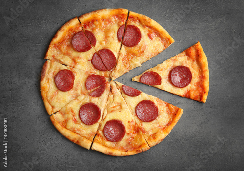 Tasty pepperoni pizza on grey table, flat lay