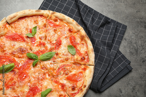Delicious pizza Margherita on grey table, top view