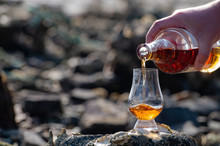 Pouring Of Scotch Whisky In Tasting Glass