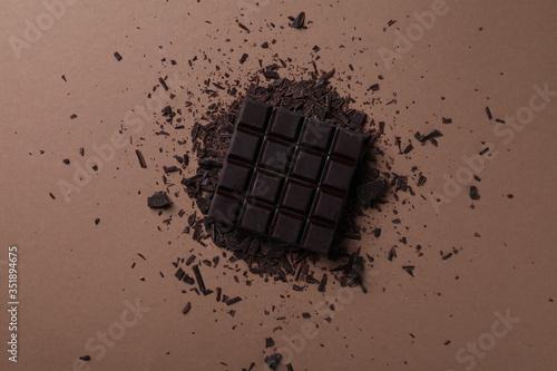 Fototapeta Tasty dark chocolate on brown background, flat lay obraz