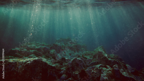 View underwater of waves breaking over rocks - 351899464