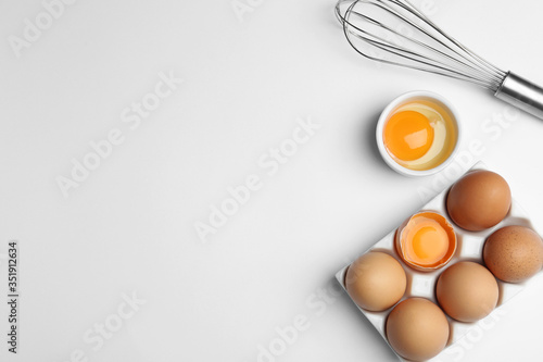 Obraz Flat lay composition with chicken eggs on white background. Space for text - fototapety do salonu