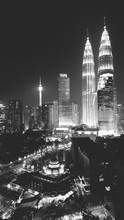 Petronas Towers Against Sky In Illuminated City At Night