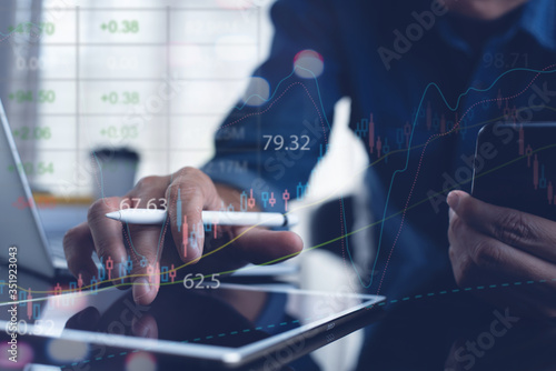 Leinwand Poster Business man analyzing stock market report with financial graph interface for bu