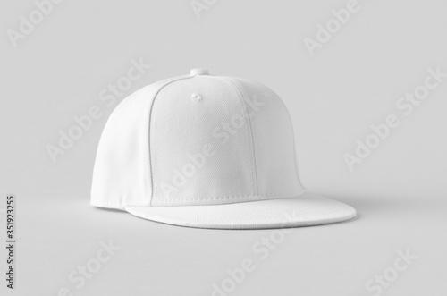 Tela White snapback cap mockup on a grey background.
