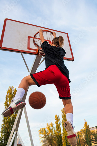 Photo Females playing basketball on street court