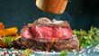 Leinwandbild Motiv Close-up of tasty beef steak on black stone table, fire flames in foreground