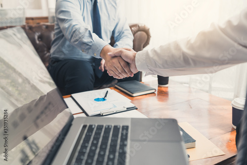 Photo Business Meeting agreement Handshake concept, Hand holding after finishing up dealing project or bargain success at negotiation over office background
