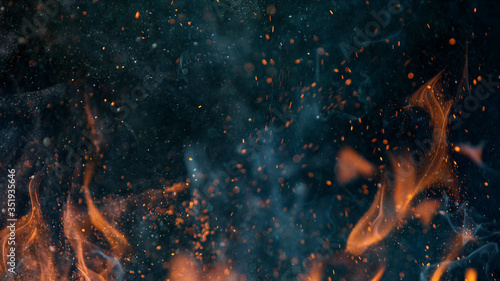 fire flames with sparks on a black background, close-up Wallpaper Mural