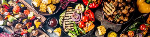 Fototapeta Assortment various barbecue vegan food, set of grill veggies, vegetable bbq party fest, grilled corn, vegan skewers kebabs, hot vegetable salad, with sauces & spices. Vegetarian seasonal summer food obraz