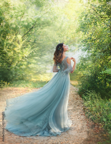 Stampa su Tela fairy tale princess in light summer blue, turquoise dress standing in park