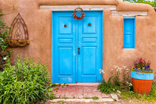 New Mexico Traditional Colorful Architecture With Blue Turquoise Adobe Color Painted Door And Ristras Decorations At Entrance Garden