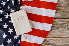 Prayer For America In Holy Bible Over USA Flag Background