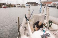 Senior Man Fixing Up His Boat