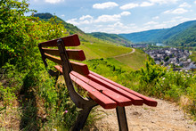 A Red Bench Standing On The Hi...
