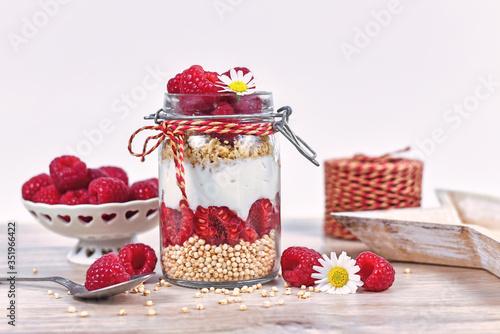 Valokuvatapetti Healthy raspberry fruit dessert with skyr yogurt, granola and puffed quinoa grai