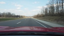 Driving Down Country Highway On Clear Blue Sunny Sky Day