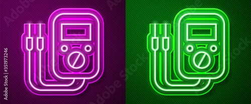 Photo Glowing neon line Ampere meter, multimeter, voltmeter icon isolated on purple and green background