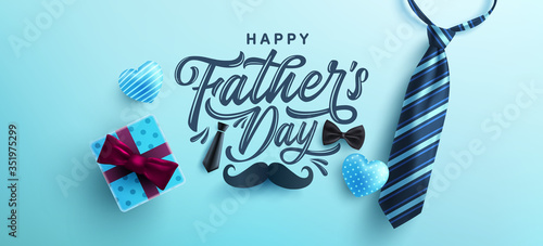 Obraz Father's Day poster or banner template with necktie and gift box on blue background.Greetings and presents for Father's Day in flat lay styling.Promotion and shopping template for love dad - fototapety do salonu