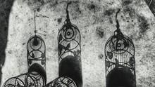 Shadows Of Birdcage On Footpath