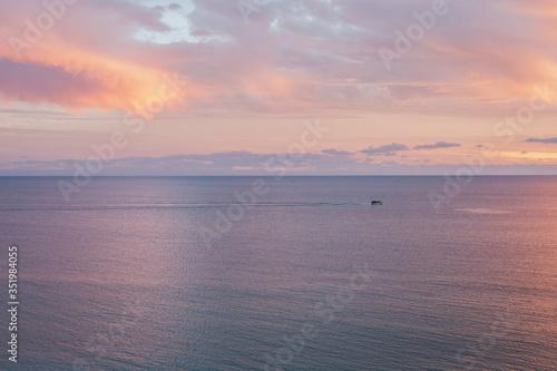 Fotografie, Obraz Motorboat In Sea At Dusk