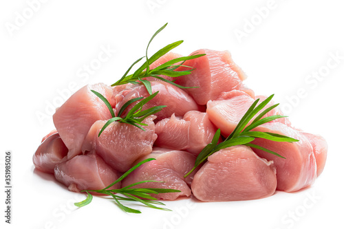 Obraz na plátně Raw chicken breast fillet chunks with tarragon herb isolated on white