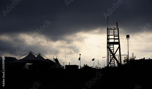 Fotografie, Obraz Silhouette Built Structures Against Cloudy Sky
