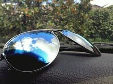 Close-up Of Sunglasses On Dash...