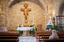 A Nun Prays Inside At The Cath...