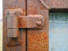Close-up Of Rusty Metal Hinge On Door