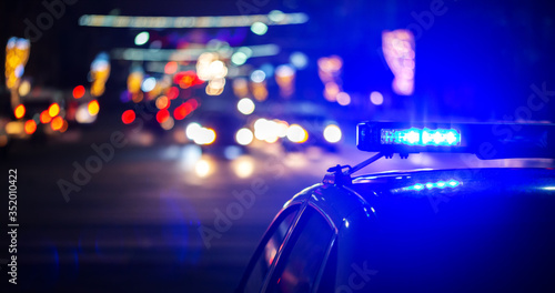 night police car lights in city - close-up with selective focus and bokeh Fototapet