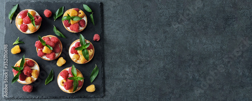 Fototapeta Tasty desserts with yellow and red raspberries. Keto desserts. Flat lay. Healthy desserts. obraz