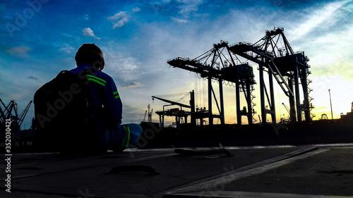 Stampa su Tela Man Sitting Against Dockyard