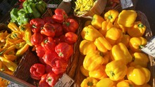High Angle View Of Bell Peppers In Baskets At Market Stall