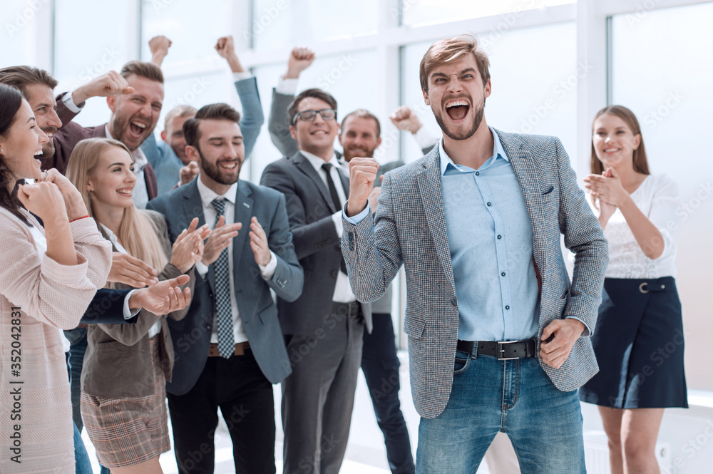Fototapeta happy business team applauding the leader of a successful projec