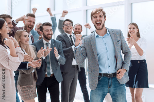 Obraz happy business team applauding the leader of a successful projec - fototapety do salonu