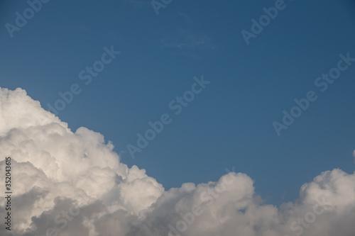Obraz Sunny cloudscape blue sky with white cumulus clouds cloudscape. Beautiful nature background backdrop sky. - fototapety do salonu