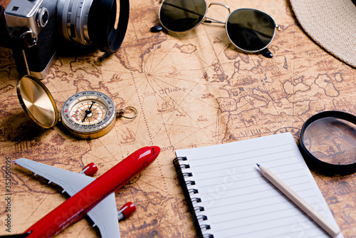 Fotografia, Obraz Compass with accessories for travel planning