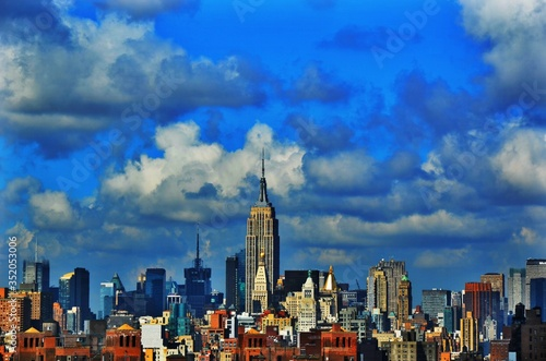 Fotografiet Cityscape With Empire State Building Against Sky