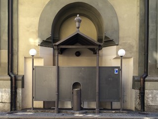 Outdoor Lavatory Against Building