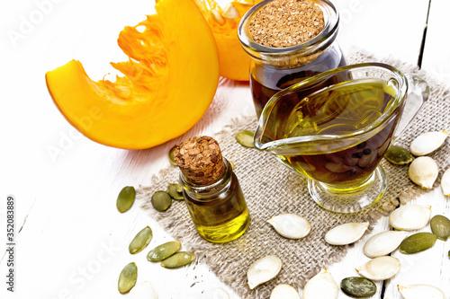 Fototapeta Oil pumpkin in vial on board obraz