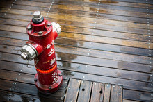 High Angle View Of Fire Hydrant On Wet Boardwalk