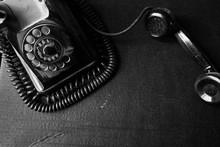 Vintage Black Old Rotary Telephone Handset On Black Background