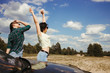 Young joyful women enjoy vacation traveling by car. Tourism lifestyle, friendship and travel concept