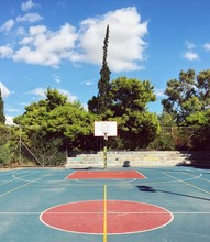 Empty Outdoor Basketball Court Against Sky